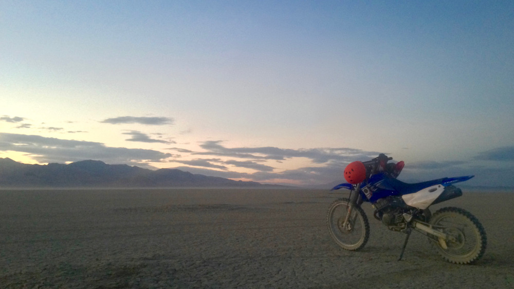 the motorbike on the playa at sunset