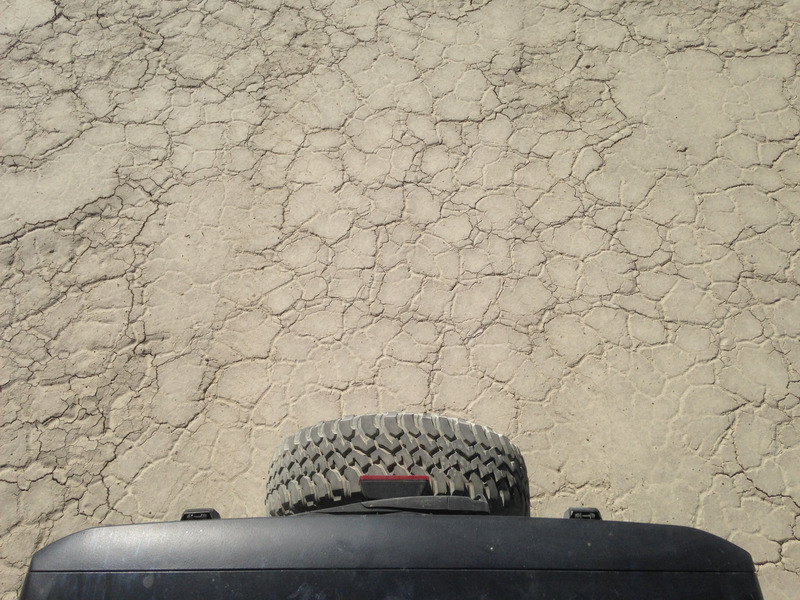 Jeep tire against the dry lakebed