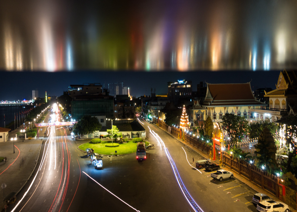 reflected traffic light trails above Sisowath Quay