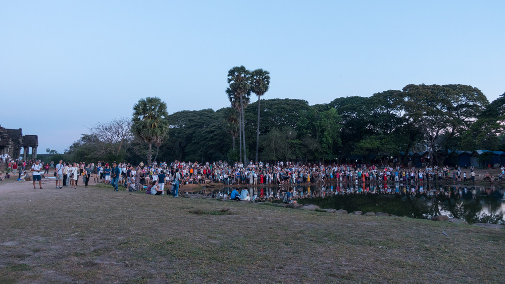 people taking sunrise pictures at Angkor Wat