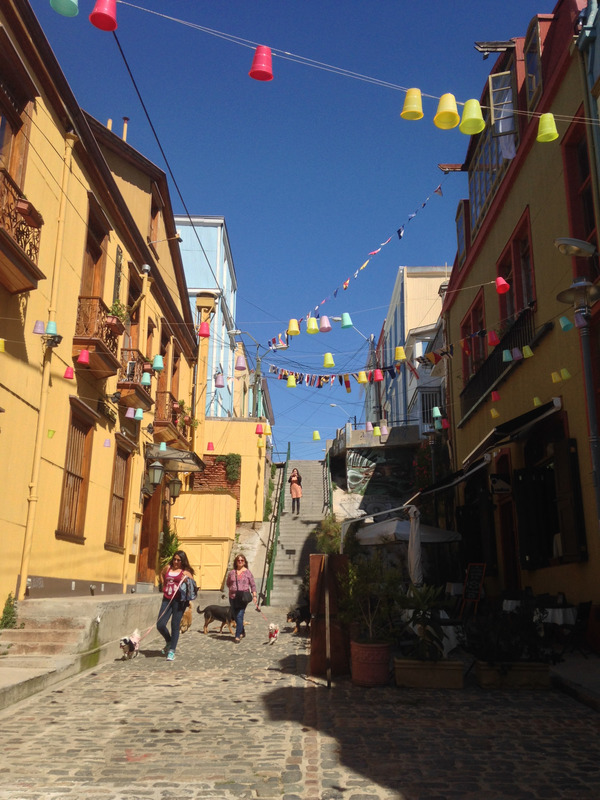 yellow buildings and overhead streamers