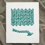 A vertical rectangular print with green ink on white paper, lying on top of a grey fabric backdrop. A rectangle of stylized stockinette stitch is at the top/middle of the work. Marks along each stitch show the direction of twist of the yarn. A single piece of yarn is depicted below, with the yarn unravelling on the right. The stitch swatch and piece of yarn are colored using pale green and yellow watercolors. The print is numbered, labeled, and signed across the bottom.