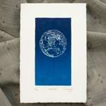 A vertical print in blue ink on white paper, with textured paper edges. The blue rectangle of the print is centered within the paper, with equal-sized margins on all sides.