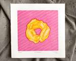 An old fashioned donut reduction print in shades of yellow and orange, with a dark pink outline and subtle yellow wavy parallel lines at an angle, on top of a bright pink square background.